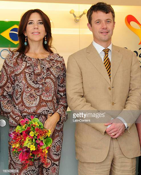 Crown Prince Frederik of Denmark and Crown Princess Mary of Denmark pose for a picture during their meeting with the Brazilian Olympic Committee in...