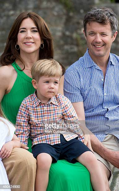 Crown Prince Frederik of Denmark and Crown Princess Mary of Denmark with Prince Vincent of Denmark attending a Photocall at Chateau de Cayx on June...