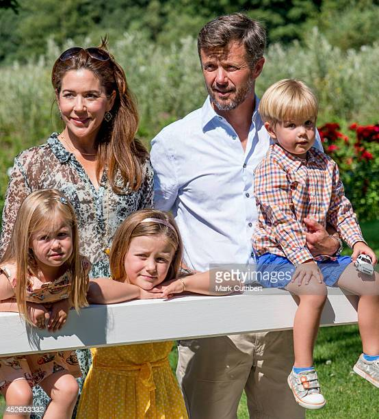 Crown Prince Frederik of Denmark and Crown Princess Mary of Denmark with Princess Isabella of Denmark Prince Vincent of Denmark and Princess...