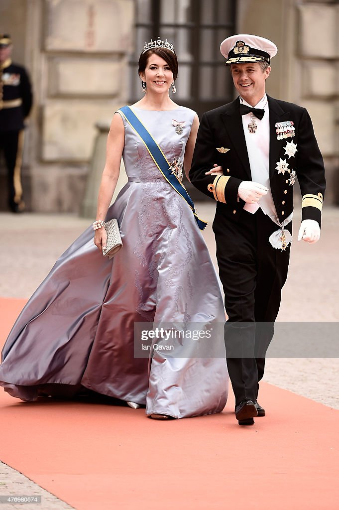 Crown <a gi-track='captionPersonalityLinkClicked' href=/galleries/search?phrase=Prince+Frederik+of+Denmark&family=editorial&specificpeople=171286 ng-click='$event.stopPropagation()'>Prince Frederik of Denmark</a> and Crown Princess Mary Of Denmark attend the royal wedding of Prince Carl Philip of Sweden and Sofia Hellqvist at The Royal Palace on June 13, 2015 in Stockholm, Sweden.