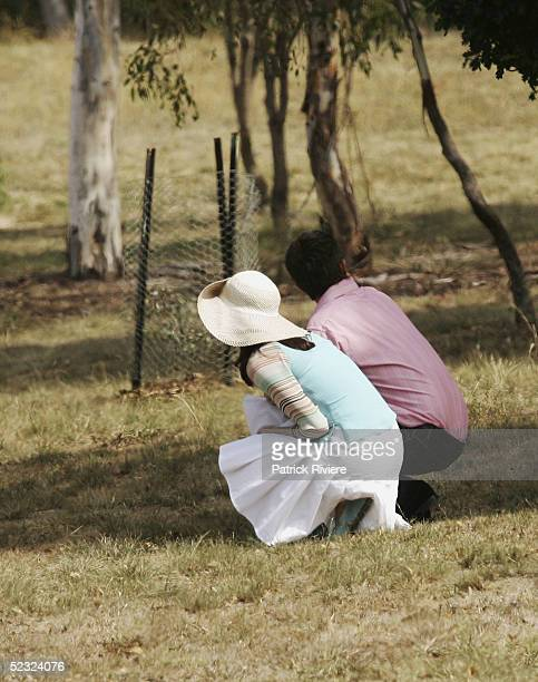 Crown Prince Frederik of Denmark and Crown Princess Mary of Denmark try to spot kangaroos whilst on a tour of the grounds of Government House with...