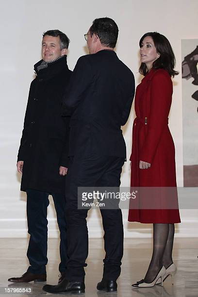 Crown Prince Frederik of Denmark and Crown Princess Mary speak with Danish artist Erik A Frandsen whose work is exhibiting in the museum at the newly...