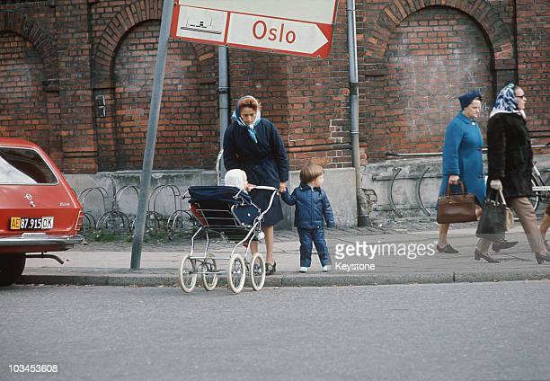 Crown Prince Frederik of Denmark and his baby brother Prince Joachim with their nanny in the streets of Copenhagen in October 1970