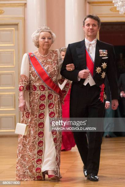Crown Prince Frederik of Denmark and Princess Beatrix of the Netherlands arrive for a gala dinner at the Royal Palace in Oslo Norway on May 9 2017 to...