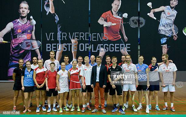 Crown Prince Frederik of Denmark and the Danish Badminton Players line up for a group shot during the Danish National Badminton Team training ahead...