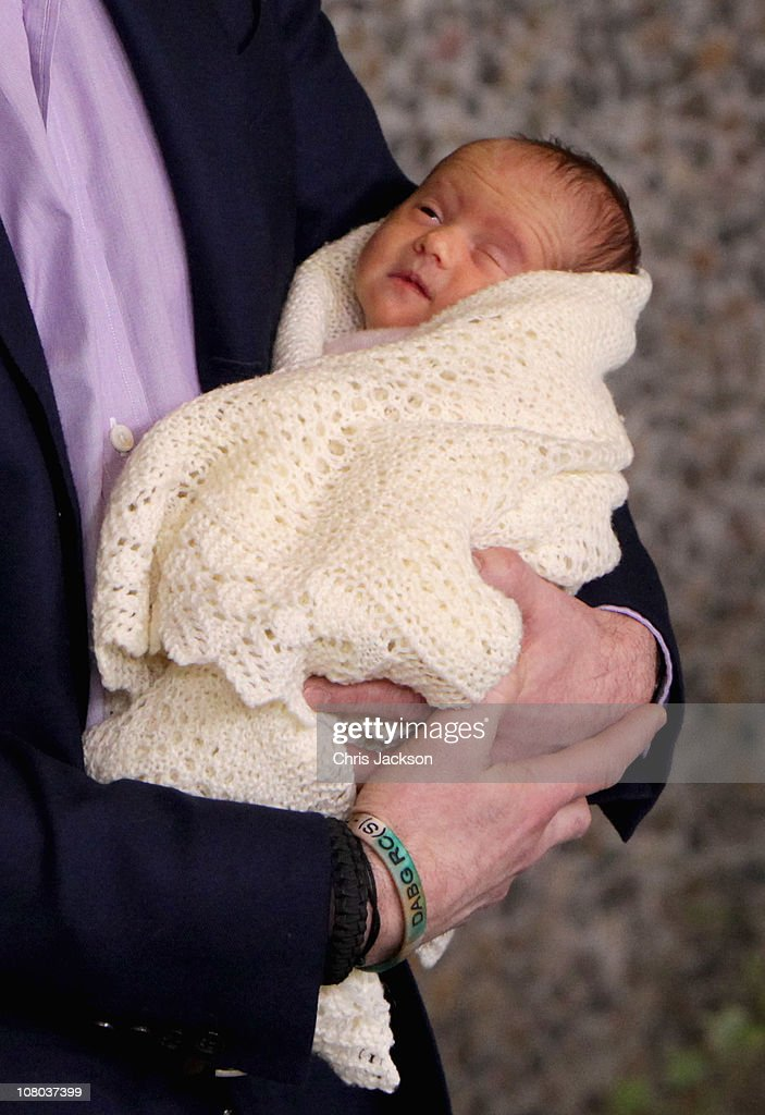 Crown Prince Frederik of Denmark holds a new-born baby twin as they leave the Rigshospitalet on January 14, 2011 in Copenhagen, Denmark. Princess Mary of Denmark gave birth to the twins, a boy and a girl on Saturday morning.