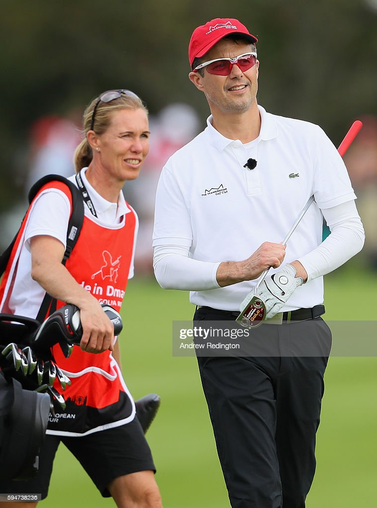crown-prince-frederik-of-denmark-is-pictured-with-his-caddie-on-the-picture-id594738236