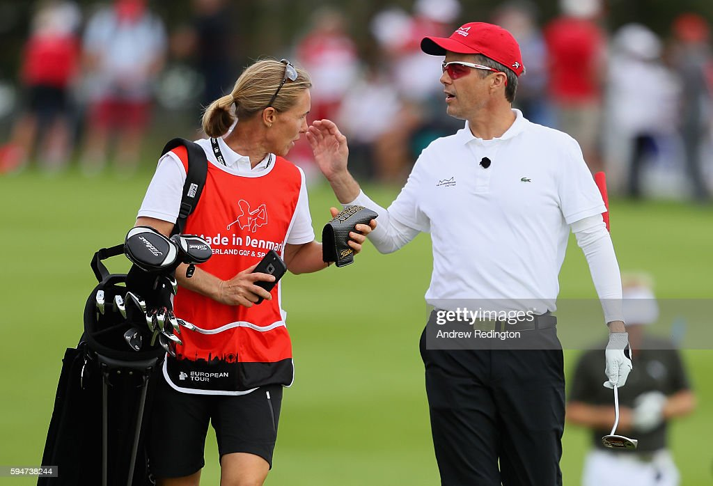 crown-prince-frederik-of-denmark-is-pictured-with-his-caddie-on-the-picture-id594738244