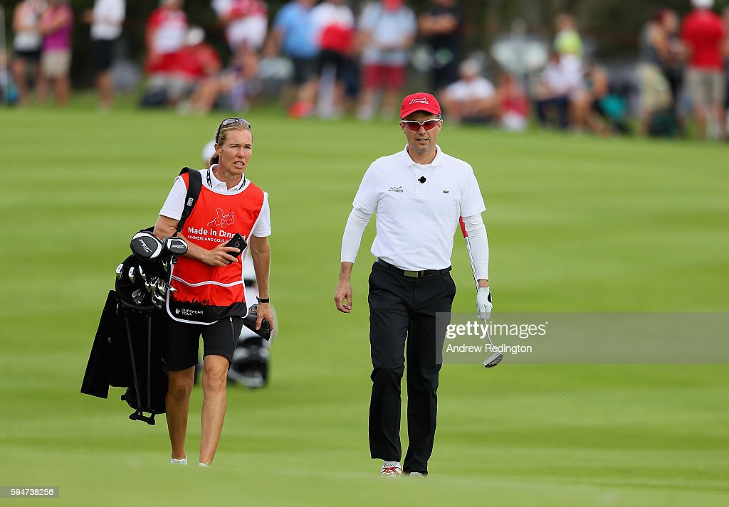 crown-prince-frederik-of-denmark-is-pictured-with-his-caddie-on-the-picture-id594738256