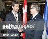 Crown Prince Frederik of Denmark shakes hands with Embassador Baruch Bina at The King David Hotel on October 30 2013 in Jerusalem Israel