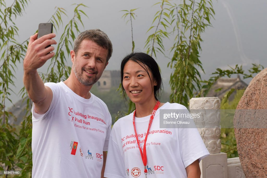 crown-prince-frederik-of-denmark-takes-a-selfie-with-a-student-in-of-picture-id853471482