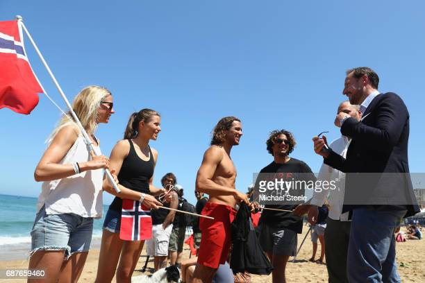 Crown Prince Haakan Of Norway chats with Norway Surf Team members Guro Aanestad Ase Odegaard Joackim Guichard and Luca Guichard during day five of...