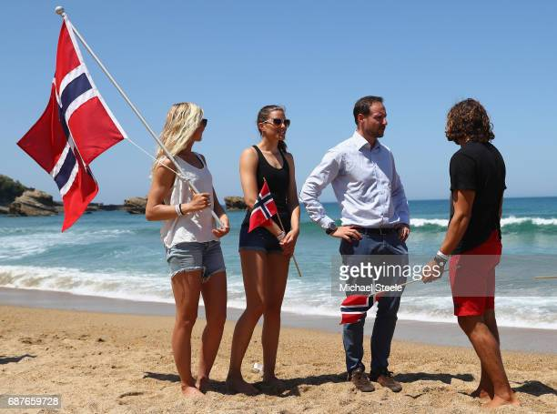 Crown Prince Haakan Of Norway chats with Norway Surf Team members Guro Aanestad Ase Odegaard and Joackim Guichard during day five of the ISA World...