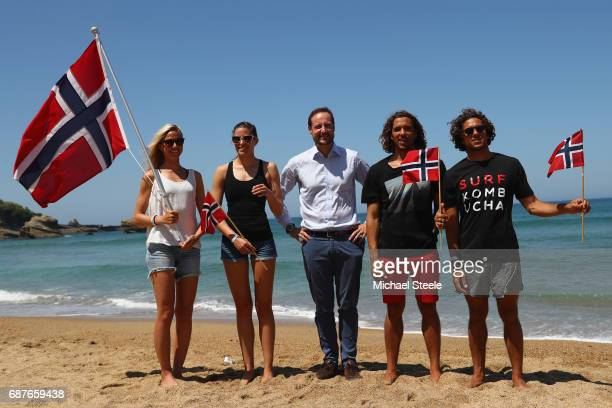 Crown Prince Haakan Of Norway poses with Norway Surf Team members Guro Aanestad Ase Odegaard Joackim Guichard and Luca Guichard during day five of...