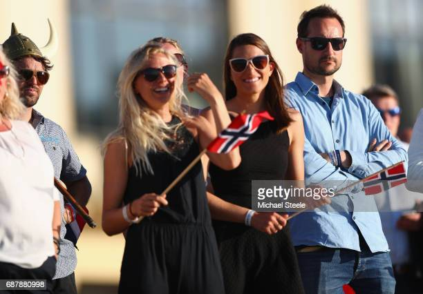 Crown Prince Haakan Of Norway watches the evening competition alongside Norway Surf Team members Guro Aanestad and Ase Odegaard during day five of...
