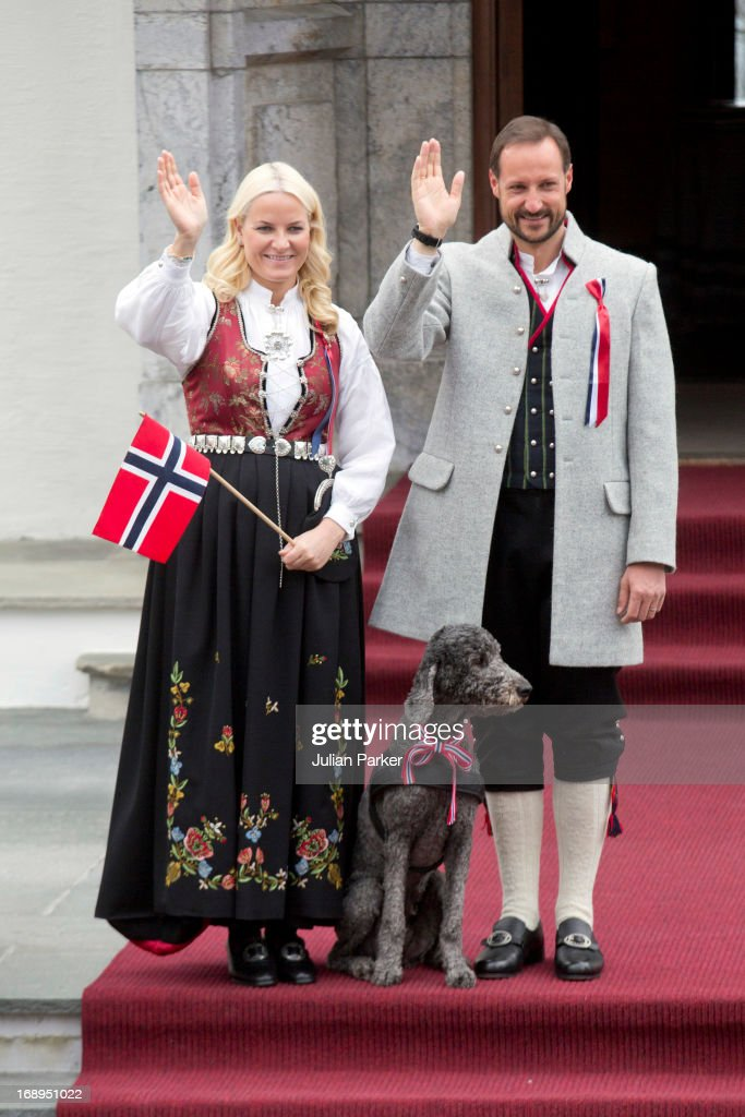 Crown Prince Haakon, and <a gi-track='captionPersonalityLinkClicked' href=/galleries/search?phrase=Crown+Princess+Mette-Marit&family=editorial&specificpeople=171288 ng-click='$event.stopPropagation()'>Crown Princess Mette-Marit</a> of Norway, and the Family Dog, Milly Kakao, celebrate Norway National Day at The Crown Prince couples residence, Skaugum, in Asker, near Oslo on May 17, 2013 in Oslo, Norway.
