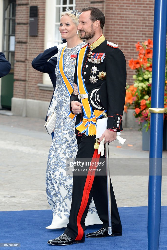 Crown Prince Haakon, and Crown Princess Mette-Marit of Norway depart the Nieuwe Kerk to return to the Royal Palace after the abdication of Queen Beatrix of the Netherlands and the Inauguration of King Willem Alexander of the Netherlands on April 30, 2013 in Amsterdam, Netherlands.