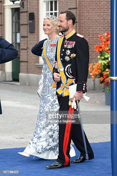 Crown Prince Haakon and Crown Princess MetteMarit of Norway depart the Nieuwe Kerk to return to the Royal Palace after the abdication of Queen...