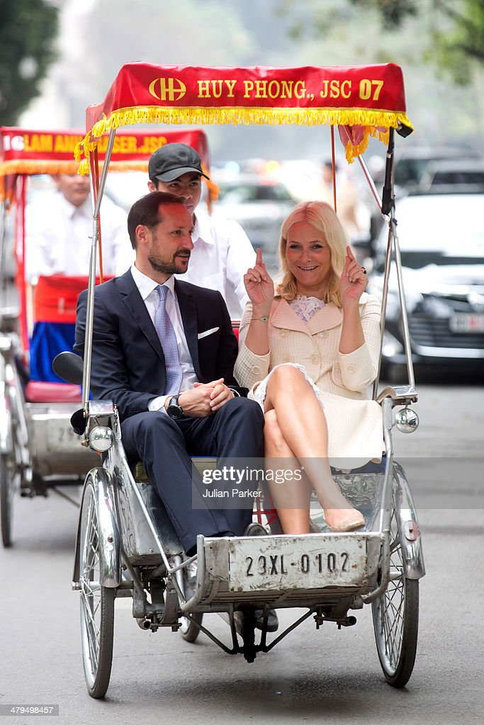 Crown Prince Haakon and <a gi-track='captionPersonalityLinkClicked' href=/galleries/search?phrase=Crown+Princess+Mette-Marit&family=editorial&specificpeople=171288 ng-click='$event.stopPropagation()'>Crown Princess Mette-Marit</a> of Norway during day 1 of an official visit to Vietnam, take a Cyclo ride back to the Sofitel Metropole Hotel on March 19, 2014 in Hanoi, Vietnam.