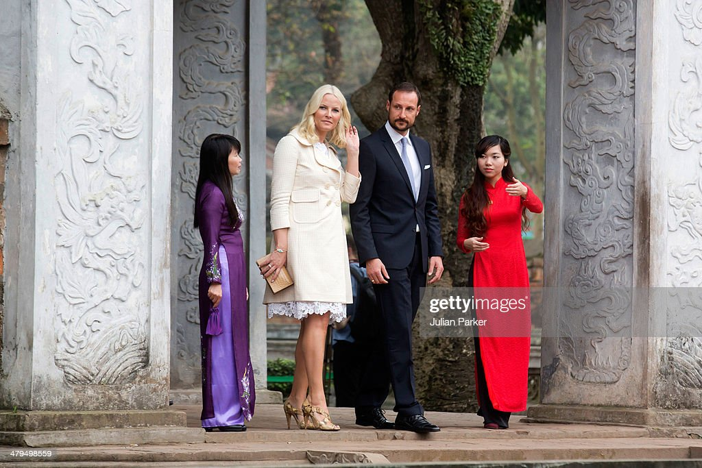 Crown Prince Haakon and <a gi-track='captionPersonalityLinkClicked' href=/galleries/search?phrase=Crown+Princess+Mette-Marit&family=editorial&specificpeople=171288 ng-click='$event.stopPropagation()'>Crown Princess Mette-Marit</a> of Norway during day 1 of an official visit to Vietnam, visit The Temple of Literature, on March 19, 2014 in Hanoi, Vietnam.