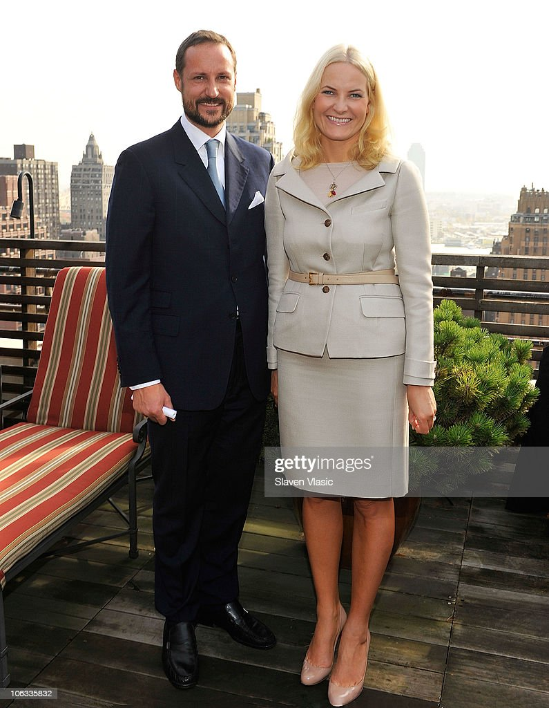 Crown Prince Haakon (L) and <a gi-track='captionPersonalityLinkClicked' href=/galleries/search?phrase=Crown+Princess+Mette-Marit&family=editorial&specificpeople=171288 ng-click='$event.stopPropagation()'>Crown Princess Mette-Marit</a> of Norway pose at the Norwegian Consul General's residence on October 28, 2010 in New York City.