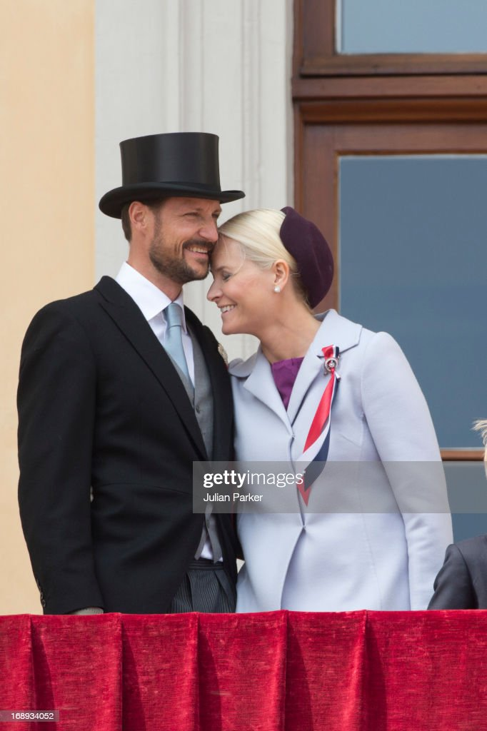Crown Prince Haakon, and <a gi-track='captionPersonalityLinkClicked' href=/galleries/search?phrase=Crown+Princess+Mette-Marit&family=editorial&specificpeople=171288 ng-click='$event.stopPropagation()'>Crown Princess Mette-Marit</a> of Norway, watch the annual Norwegian National Day parade from the balcony of The Royal Palace in Oslo on May 17, 2013 in Oslo, Norway.