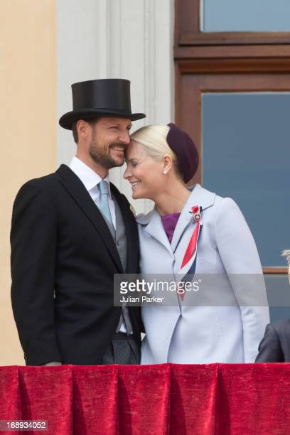 Crown Prince Haakon and Crown Princess MetteMarit of Norway watch the annual Norwegian National Day parade from the balcony of The Royal Palace in...