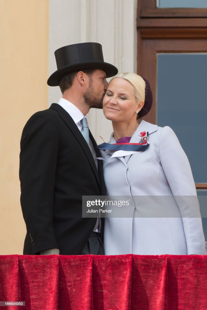 Crown Prince Haakon, and Crown Princess Mette-Marit of Norway, watch the annual Norwegian National Day parade from the balcony of The Royal Palace in Oslo on May 17, 2013 in Oslo, Norway.
