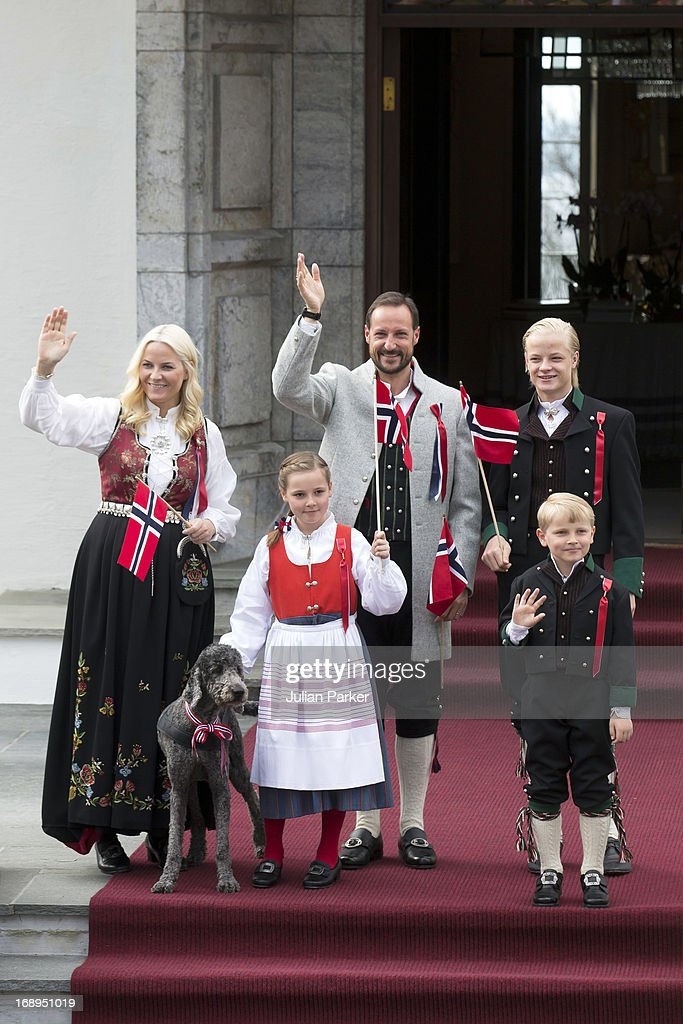 Crown Prince Haakon, and <a gi-track='captionPersonalityLinkClicked' href=/galleries/search?phrase=Crown+Princess+Mette-Marit&family=editorial&specificpeople=171288 ng-click='$event.stopPropagation()'>Crown Princess Mette-Marit</a> of Norway, with there children, <a gi-track='captionPersonalityLinkClicked' href=/galleries/search?phrase=Princess+Ingrid+Alexandra&family=editorial&specificpeople=243087 ng-click='$event.stopPropagation()'>Princess Ingrid Alexandra</a>, and Prince Sverre Magnus, and Mette's son Marius, and Family Dog,Milly Kakao, celebrate Norway National Day at The Crown Prince couples residence, Skaugum, in Asker, near Oslo on May 17, 2013 in Asker, Norway.