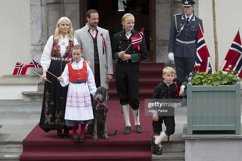 Crown Prince Haakon, and <a gi-track='captionPersonalityLinkClicked' href=/galleries/search?phrase=Crown+Princess+Mette-Marit&family=editorial&specificpeople=171288 ng-click='$event.stopPropagation()'>Crown Princess Mette-Marit</a> of Norway, with there children, <a gi-track='captionPersonalityLinkClicked' href=/galleries/search?phrase=Princess+Ingrid+Alexandra&family=editorial&specificpeople=243087 ng-click='$event.stopPropagation()'>Princess Ingrid Alexandra</a>, and Prince Sverre Magnus, and Mette's son Marius, and Family Dog, Milly Kakao, celebrate Norway National Day at The Crown Prince couples residence, Skaugum, in Asker, near Oslo on May 17, 2013 in Asker, Norway.
