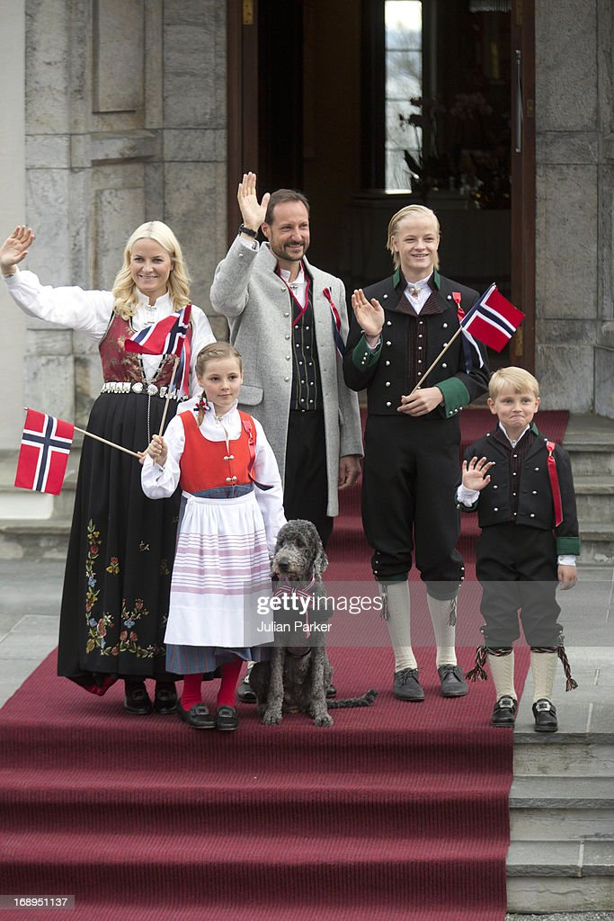 Crown Prince Haakon, and Crown Princess Mette-Marit of Norway, with there children, Princess Ingrid Alexandra, and Prince Sverre Magnus, and Mette's son Marius, and Family Dog, Milly Kakao celebrate Norway National Day at The Crown Prince couples residence, Skaugum, in Asker, near Oslo on May 17, 2013 in Oslo, Norway.