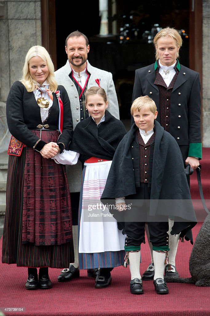 Crown Prince Haakon, and Crown Princess Mette-Marit of Norway, with Princess Ingrid Alexandra, and Prince Sverre Magnus, and Crown Princess Mette-Marit's son Marius Borg Hoiby (R) watch the traditional morning children's parade, at their home, Skaugum, in Asker, near Oslo, on Norway's National Day, on May 17, 2015 in Oslo, Norway.
