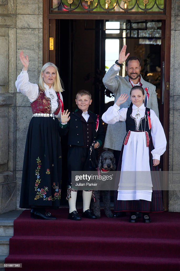 Crown Prince Haakon, and Crown Princess Mette-Marit of Norway, with their children Princess Ingrid Alexandra, and Prince Sverre Magnus, and their family pet dog, Milly Kakao, attend the traditional morning children's parade, at their home, Skaugum, in Asker, near Oslo, on Norway's National Day, on May 17, 2016 in Oslo, Norway.