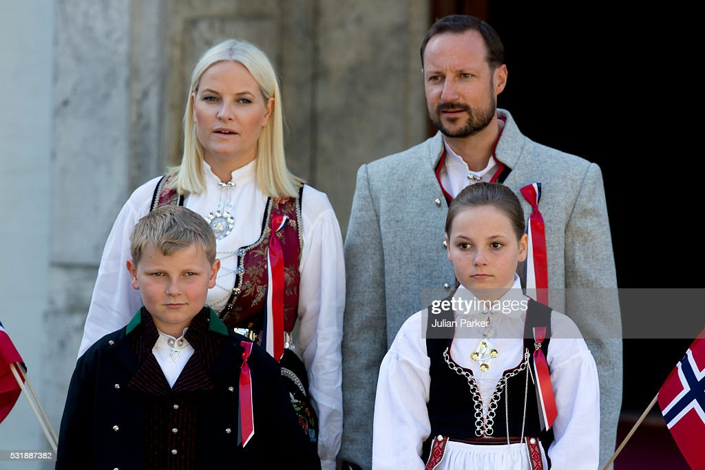 Crown Prince Haakon, and Crown Princess Mette-Marit of Norway, with their children Princess Ingrid Alexandra, and Prince Sverre Magnus attend the traditional morning children's parade, at their home, Skaugum, in Asker, near Oslo, on Norway's National Day, on May 17, 2016 in Oslo, Norway.