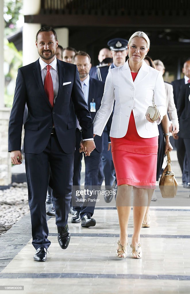 <a gi-track='captionPersonalityLinkClicked' href=/galleries/search?phrase=Crown+Prince+Haakon+of+Norway&family=editorial&specificpeople=158362 ng-click='$event.stopPropagation()'>Crown Prince Haakon of Norway</a> and <a gi-track='captionPersonalityLinkClicked' href=/galleries/search?phrase=Crown+Princess+Mette-Marit&family=editorial&specificpeople=171288 ng-click='$event.stopPropagation()'>Crown Princess Mette-Marit</a> of Norway arrive to take part in a Norwegian seafood promotion,master class, at The Shangri-La Hotel,in Jarkarta during an official 3-day visit to Indonesia, on November 26, 2012 in Jakarta, Indonesia. The visit intends to strengthen and develop the existing relationship between the countries, especially in relation to the energy, maritime, trade and investment sectors.