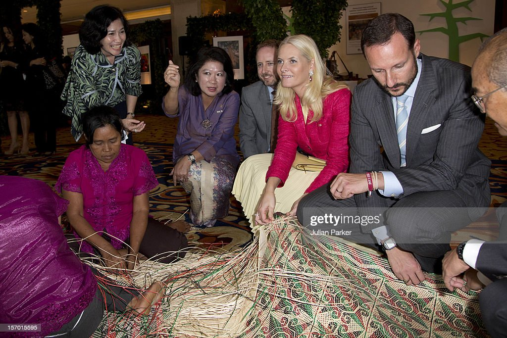 <a gi-track='captionPersonalityLinkClicked' href=/galleries/search?phrase=Crown+Prince+Haakon+of+Norway&family=editorial&specificpeople=158362 ng-click='$event.stopPropagation()'>Crown Prince Haakon of Norway</a> and <a gi-track='captionPersonalityLinkClicked' href=/galleries/search?phrase=Crown+Princess+Mette-Marit&family=editorial&specificpeople=171288 ng-click='$event.stopPropagation()'>Crown Princess Mette-Marit</a> of Norway tour an eco marketplace exhibition at The Shangri-La Hotel, Jakarta, during an official 3-day visit to Indonesia, on November 27, 2012 in Jakarta, Indonesia. The visit intends to strengthen and develop the existing relationship between the countries, especially in relation to the energy, maritime, trade and investment sectors.