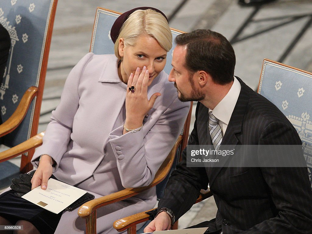 Crown Prince Haakon of Norway and Crown Princess Mette-Marit of Norway whisper to each other at the Nobel Peace Prize Ceremony 2008 in Oslo City Hall on December 10, 2008 in Oslo, Norway. The Norwegian Nobel Committee has decided to award the Nobel Peace Prize for 2008 to Martti Ahtisaari for his important efforts, on several continents and more than three decades, to resolve international conflicts.