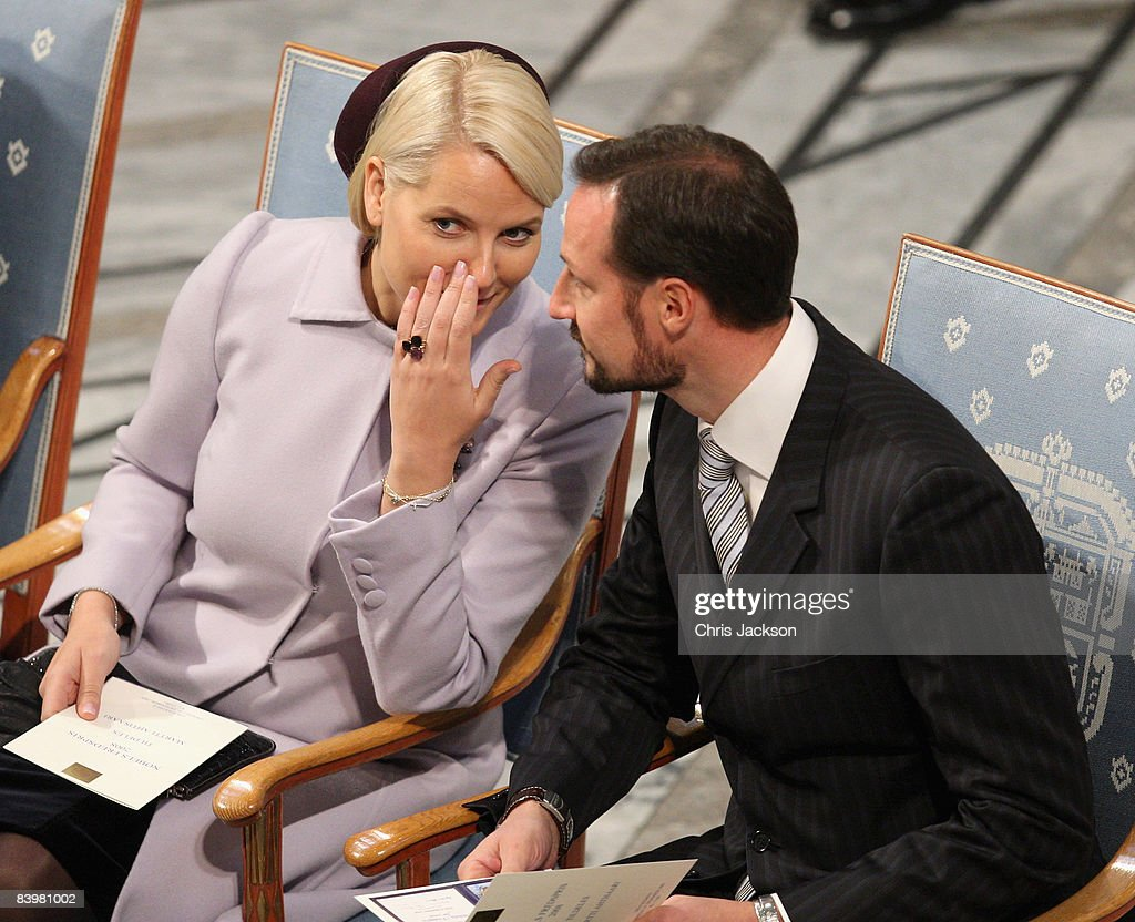Crown Prince Haakon of Norway and Crown Princess Mette-Marit talk to each other at the Nobel Peace Prize Ceremony 2008 in Oslo City Hall on December 10, 2008 in Oslo, Norway. The Norwegian Nobel Committee has decided to award the Nobel Peace Prize for 2008 to Martti Ahtisaari for his important efforts, on several continents and morethan three decades, to resolve international conflicts.