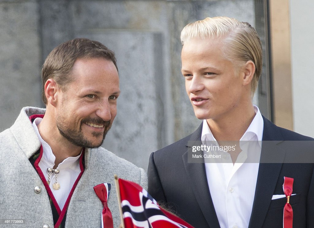 Ê Crown Prince Haakon of Norway and <a gi-track='captionPersonalityLinkClicked' href=/galleries/search?phrase=Marius+Hoiby&family=editorial&specificpeople=220166 ng-click='$event.stopPropagation()'>Marius Hoiby</a> greet the Childrens Parade on the Skaugum Estate on May 17, 2014 in Oslo, Norway.Ê