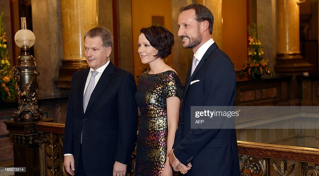 Crown Prince Haakon of Norway (R) pose for a photo with President of Finland Sauli Niinistö and his wife Jenni Haukio ahead of a dinner in Helsinki, Finland, on October 22, 2013.