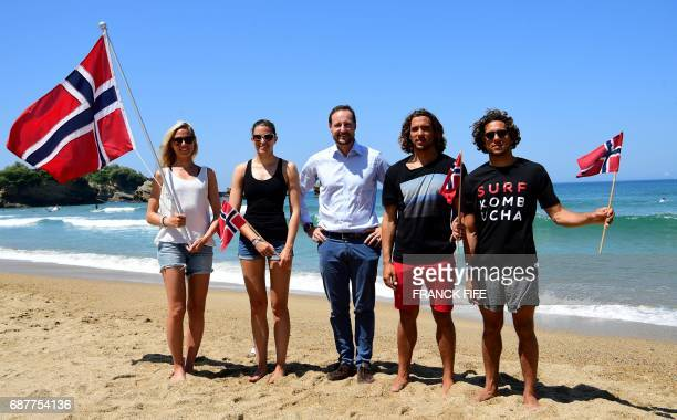 Crown Prince Haakon of Norway poses with Norway Surf Team members Guro Aanestad Ase Odegaard Joackim Guichard and Luca Guichard on May 24 2017 in...