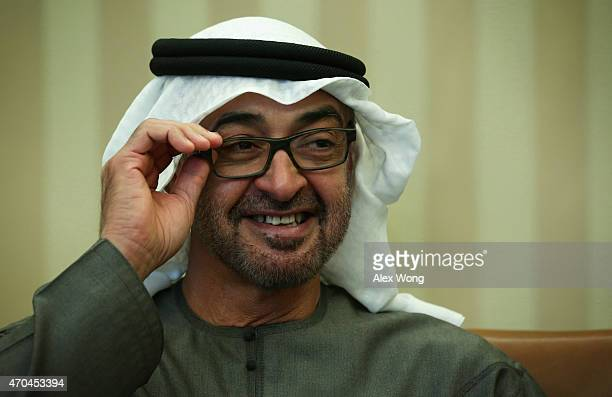 Crown Prince Mohammed Bin Zayed Al Nahyan of Abu Dhabi and deputy supreme commander of the United Arab Emirates Armed Forces adjusts his eyeglasses...
