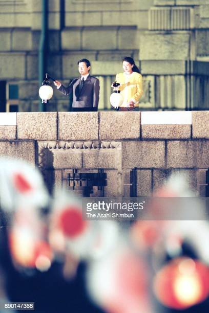 Crown Prince Naruhito and Crown Princess Masako are seen as participants celebrate their wedding at Jingu Gaien Park on June 12 1993 in Tokyo Japan