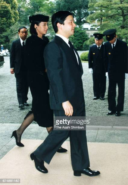 Crown Prince Naruhito and Crown Princess Masako are seen at Toshimagaoka Cemetery to make a condolence visit for late Kazuko Fushimi wife of former...