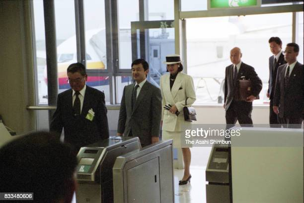 Crown Prince Naruhito and Crown Princess Masako are seen on arrival at Komatsu Airport on September 24 1994 in Komatsu Ishikawa Japan