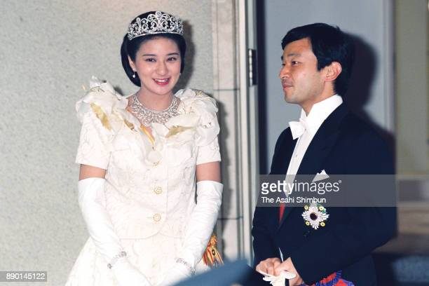 Crown Prince Naruhito and Crown Princess Masako are seen on arrival at the Togu Palace after the royal wedding parade on June 9 1993 in Tokyo Japan