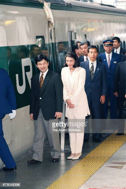 Crown Prince Naruhito and Crown Princess Masako are seen on departure for the Nasu Imperial Villa at Tokyo Station on May 1 1997 in Tokyo Japan