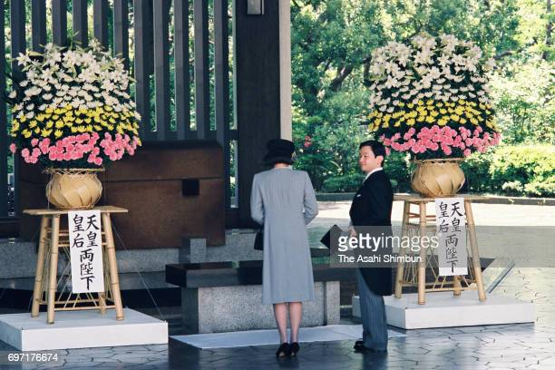 Crown Prince Naruhito and Crown Princess Masako attend a memorial ceremony at the Chidorigafuchi National Cemetery on May 20 1995 in Tokyo Japan