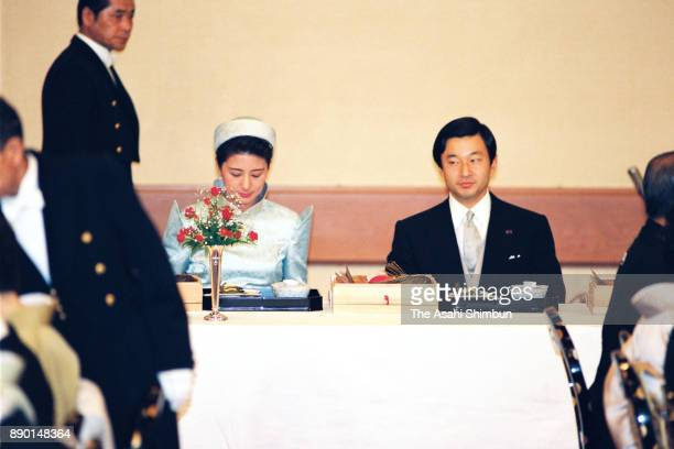 Crown Prince Naruhito and Crown Princess Masako attend the 'Kyuchu KyoennoGi' wedding dinner at the Imperial Palace on June 16 1993 in Tokyo Japan