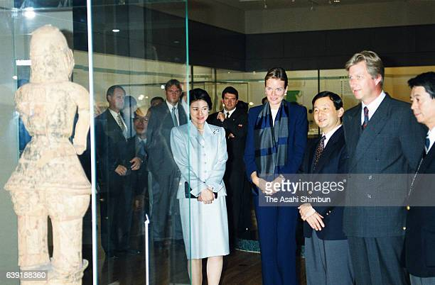Crown Prince Naruhito and Crown Princess Masako introduce exhibits to Crown Prince Philippe and Crown Princess Mathilde of Belgium at the Tokyo...